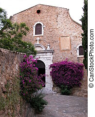 Church facade with bougainvillea flowers