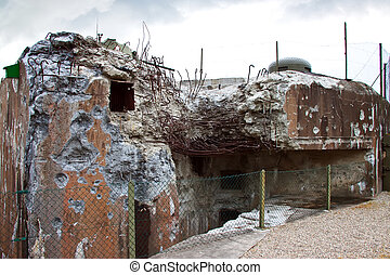 The Maginot Line was a line of concrete fortifications, tank...
