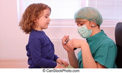 doctor gives a little girl a cure - female doctor gives a...