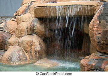 An artificial grotto with a waterfall.
