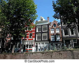 Ancient houses in Amsterdam, view from the canal, Netherland
