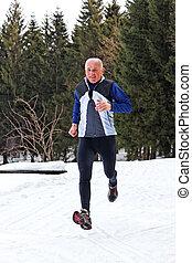 Senior running jogging in winter