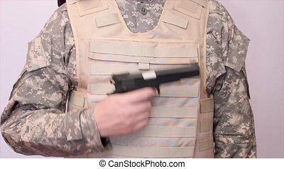 soldier unloading gun