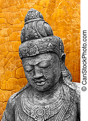Khmer Style Statue - A cast Khmer style statue against an...