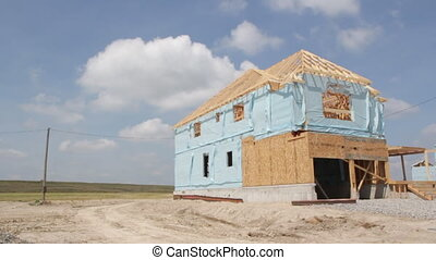 New house construction - A new suburban house under...
