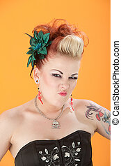 Woman Shrivels Her Nose - Retro-styled woman on orange...