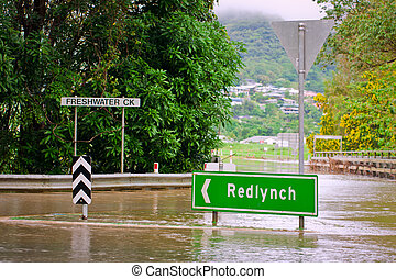Flooded roundabout and bridge in Queensland, Australia -...