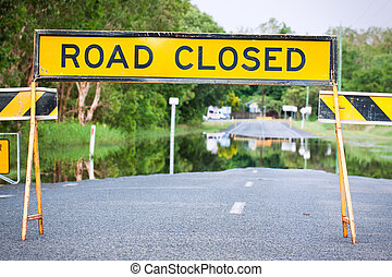 Road closed traffic sign on a flooded road - A road closed...