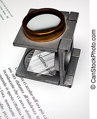 Text and loupe on printed sheet