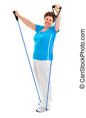 fitness - senior woman doing exercises with a resistance...