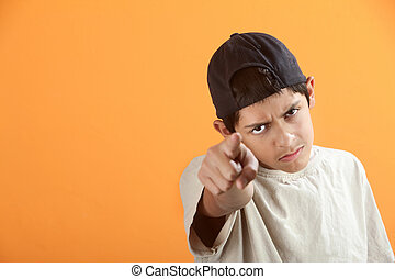 Teen Points Finger - Serious or angry Latino kid points...