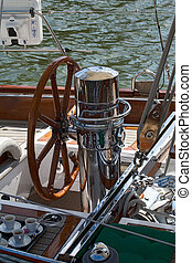 Rudder on a wooden boat - Rudder and coffee cup on a wooden...