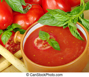 Tomato Soup with Basil - Tomato soup in bowl in between...