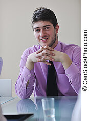 young business man alone in conference room - young business...