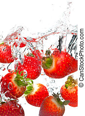 Strawberries falling in water - Photo of strawberries...