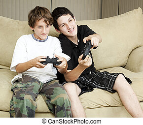 Brothers Play Video Games - Two brothers at home playing...