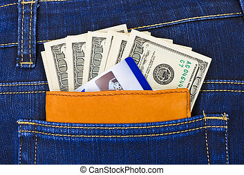 Money and credit card in jeans pocket - shopping background