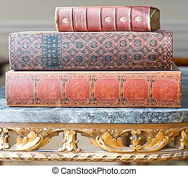 Antique Leatherbound Books - Old leatherbound books on an...