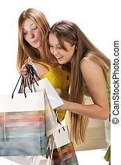Shopping. Two beautiful girl with bag isolated on white...