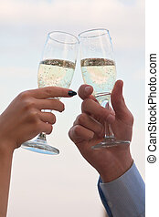 Champagne toast - Male and female hands with champagne in...