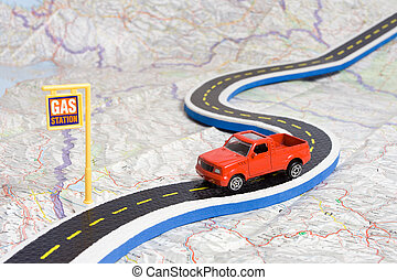 car on roadmap - toy car on roadmap showing petrol station...