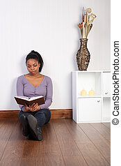 Beautiful woman relaxing at home reading a book