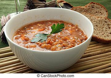 Lentil soup - a white bowl of red lentil soup