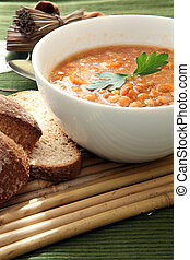 Lentil soup - a white bowl of red lentil soup