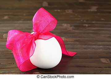 Festive Easter Egg Tied with Purple Ribbon