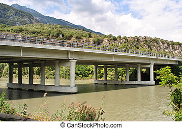 highway bridge seen from the river adige