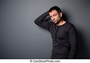 Depressed man looking down - Portrait of depressed man...