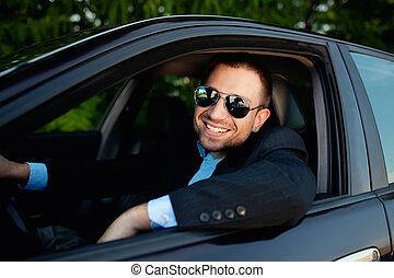 Businessman in car smiling - businessman in car smiling