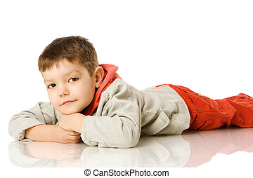 Four years boy lying on floor isolated on white