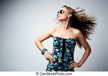 Glamour woman dancing - Glamour woman posing in studio with...