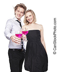 Young couple toasting with pink drink Two people drinking...