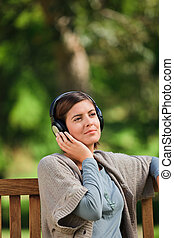 Young woman listening to some music