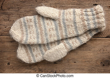 mittens on a wooden background