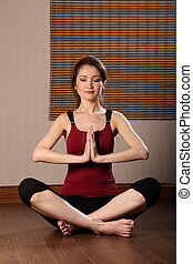Woman meditating with eyes closed