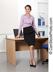 Business woman standing in office - Full body shot of...