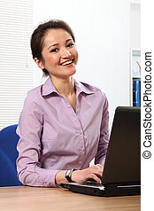 Asian business woman with laptop - Beautiful young Asian...
