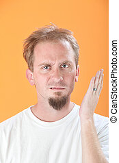 Man Gestures a Slap - Caucasian man gestures a slap in the...