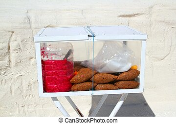 Kibis yucatecos mayan food from Mexico in portable glass box
