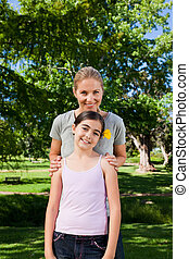 Cute daughter with her mother in the park