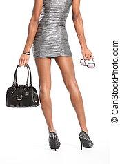 Long legs of model in silver dress