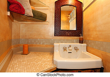 Antique sink with faux orange wall and mirror