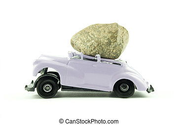 car insurance - a boulder has fallen on top of a toy car...