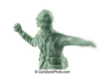 toy soldier throwing grenade - front view of an old toy...