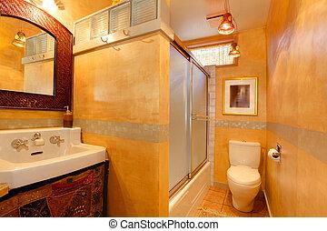 Exotic orange artistic bathroom with antique sink