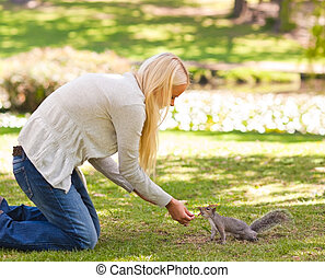 Beautiful woman with a squirrel