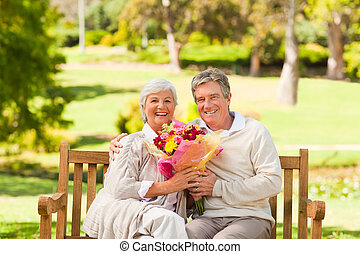 Senior man offering flowers to his wife